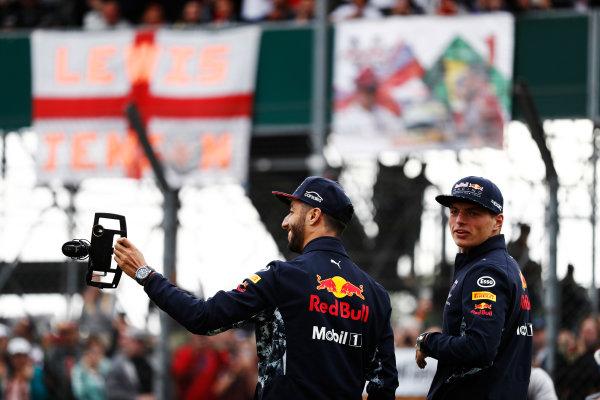 Silverstone, Northamptonshire, UK.  Thursday 13 July 2017. Daniel Ricciardo, Red Bull Racing, and Max Verstappen, Red Bull Racing, film fans. World Copyright: Glenn Dunbar/LAT Images  ref: Digital Image _31I2235