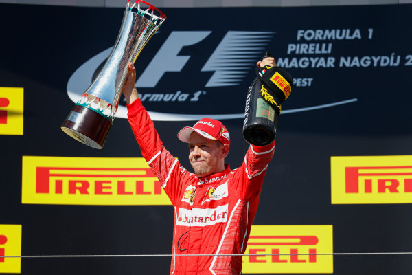 Hungaroring, Budapest, Hungary.  Sunday 30 July 2017. Sebastian Vettel, Ferrari, 1st Position, with his trophy. World Copyright: Glenn Dunbar/LAT Images  ref: Digital Image _X4I2917