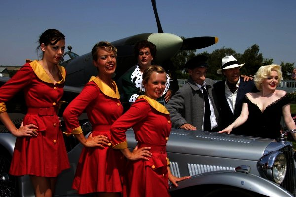 2006 Goodwood Revival Press Day. Goodwood, West Sussex. 19th July 2006. Lord March with Marilyn Monroe and Glamcabs.World Copyright: Gary Hawkins/LAT Photographic. Ref: Digital Image Only.