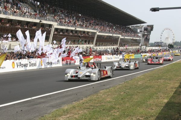 2006 Le Mans 24 Hours, Le Mans, France.14th - 18th June. F Biela (DEU)/ E Pirro (ITA)/ M Werner (DEU), Audi Sport Team Joest. and R Capello (ITA)/ T Kristensen (DNK)/ A McNish (GBR), Audi Sport Team Joest. Drive past their Audi team. Win. World Copyright: Kevin Wood/LAT PhotographicRef: Digital Image Only IMG_4245