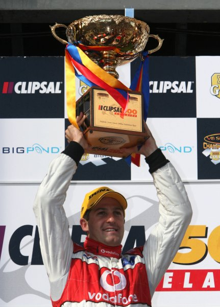 The Triple Eight Racing V8 Supercar of Jamie Whincup holds the trophy aloft after winning the Clipsal 500, Round 01 of the Australian V8 Supercar Championship Series at the Adelaide Street Circuit, Adelaide, South Australia, February 24, 2008.