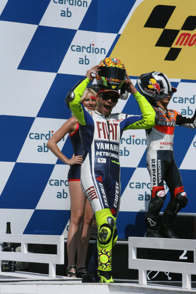 Brno, Czech Republic. 14th - 16th August.Valentino Rossi Fiat Yamaha Team celebrates his win on the podium.World Copyright: Martin Heath/LAT Photographic ref: Digital Image SE5K3964
