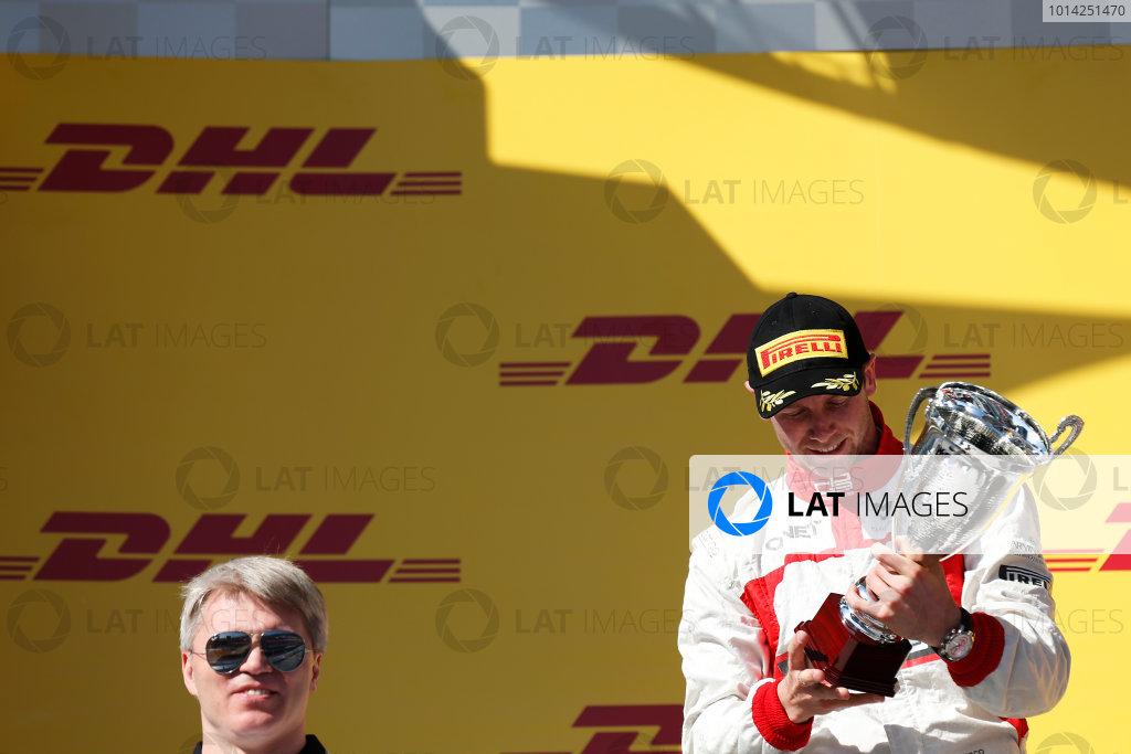 2014 GP3 Series. Round 8.   Sochi Autodrom, Sochi, Russia. Sunday Race 2 Sunday 12 October 2014. Dean Stoneman (GBR, Marussia Manor Racing) on the podium. Photo: Alastair Staley/GP3 Series Media Service. ref: Digital Image _79P5805