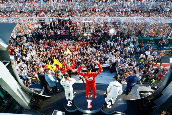 Albert Park, Melbourne, Australia. Sunday 26 March 2017. Sebastian Vettel, Ferrari, 1st Position, Lewis Hamilton, Mercedes AMG, 2nd Position, and Valtteri Bottas, Mercedes AMG, 3rd Position, celebrate on the podium. World Copyright: Steven Tee/LAT Images Ref: Digital Image _O3I3202