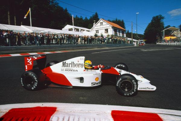 1991 Belgian Grand Prix. Spa-Francorchamps, Belgium.23-25 August 1991. Ayrton Senna (McLaren MP4/6 Honda) 1st position at La Source Hairpin, action. World Copyright: LAT Photographic Ref: 91 BEL 22.
