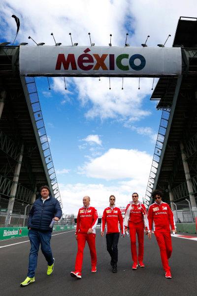 Autodromo Hermanos Rodriguez, Mexico City, Mexico. Thursday 27 October 2016. Sebastian Vettel, Ferrari, walks the track with his team. World Copyright: Sam Bloxham/LAT Photographic ref: Digital Image _SBB2302