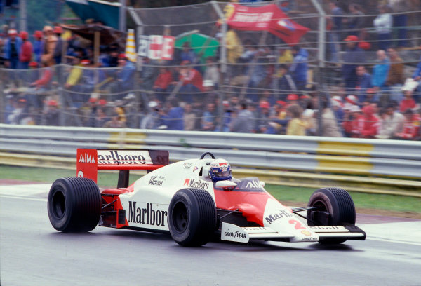 1985 San Marino Grand Prix. Imola, Italy. 3-5 May 1985. Alain Prost (McLaren MP4/2B TAG Porsche) 1st position, but later disqualified due to the car being under weight at the finish. Ref-85 SM 31. World Copyright - LAT Photographic