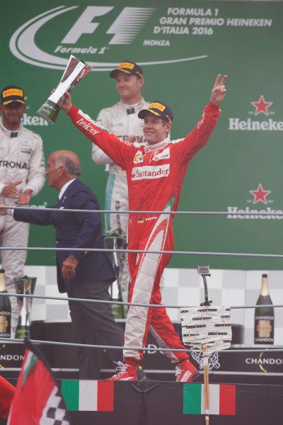 Autodromo Nazionale di Monza, Italy. Sunday 04 September 2016. Sebastian Vettel, Ferrari, 3rd Position, with his trophy on the podium. World Copyright: Sam Bloxham/LAT Photographic ref: Digital Image _SLA8683