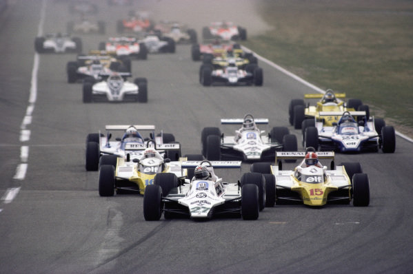 Alan Jones, Williams FW07B Ford, leads the Renault RE20s of Jean-Pierre Jabouille and Rene Arnoux.