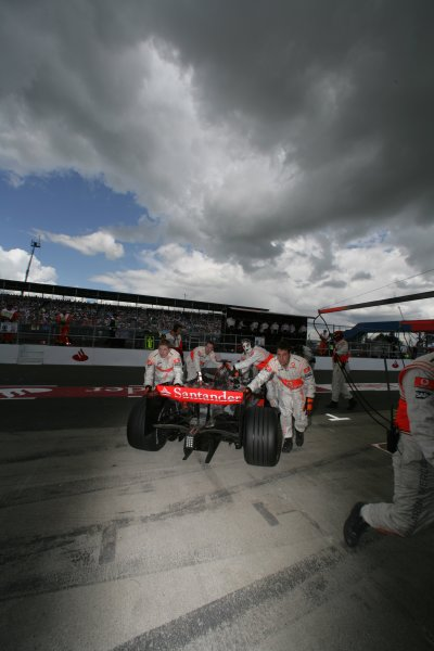 2007 British Grand Prix - Saturday QualifyingSilverstone, Northamptonshire, England.7th July 2007.Lewis Hamilton, McLaren MP4-22 Mercedes, is pushed into the McLaren garage. Garages.World Copyright: Steven Tee/LAT Photographicref: Digital Image YY2Z5573