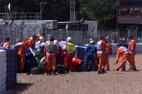 1999 British Grand Prix. Silverstone, England. 9th - 11th July 1999. Michael Schumacher (Ferrari F399), crashes heavily into the tyre barriers at Stowe on the first lap, breaking his leg. World Copyright: LAT Photographic.  Ref:  99_GB_MS_Crash_05.