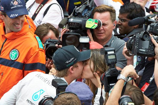 Monte Carlo, Monaco. Sunday 25 May 2014. Nico Rosberg, Mercedes AMG, 1st Position, celebrates victory with a kiss. World Copyright: Steve Etherington/LAT Photographic. ref: Digital Image SNE12249 copy