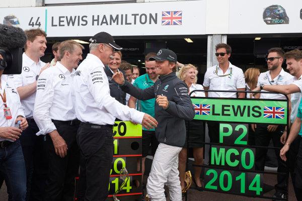 Monte Carlo, Monaco. Sunday 25 May 2014. Dr Dieter Zetsche, CEO, Mercedes Benz, congratulates Nico Rosberg, Mercedes AMG, 1st Position. World Copyright: Steve Etherington/LAT Photographic. ref: Digital Image SNE20123 copy