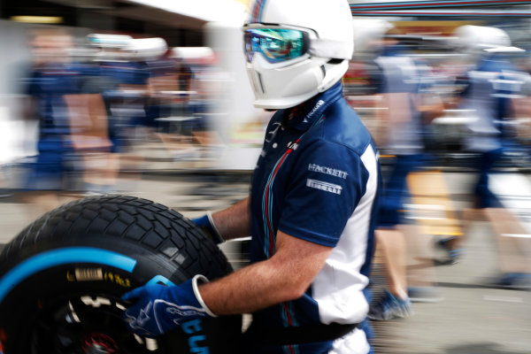 Hockenheim, Germany. Thursday 28 July 2016. A Williams mechanic carries a wet weather tyre during a practice pit stop. World Copyright: Dunbar/LAT Photographic ref: Digital Image _W2Q9538