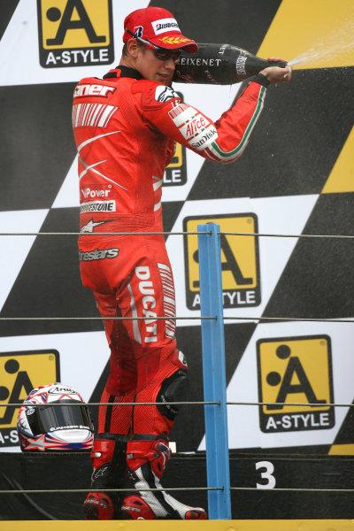 TT Circuit Assen, Netherlands. 28th June 2008.MotoGP Race.Casey Stoner Ducati Marlboro Team with the winners champagne.World Copyright: Martin Heath / LAT Photographicref: Digital Image Only