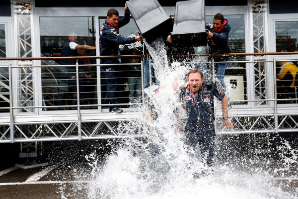 Spa-Francorchamps, Spa, Belgium. Saturday 23 August 2014. Adrian Newey, Chief Technical Officer, Red Bull Racing, and Christian Horner, Team Principal, Red Bull Racing. receive a soaking from Sebastian Vettel, Red Bull Racing, and Daniel Ricciardo, Red Bull Racing, after being nominated for the Ice Bucket Challenge. World Copyright: Alastair Staley/LAT Photographic. ref: Digital Image _R6T4861