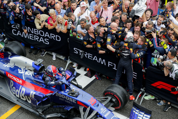 Race winner Max Verstappen, Red Bull Racing celebrates with his team in Parc Ferme and Daniil Kvyat, Toro Rosso STR14