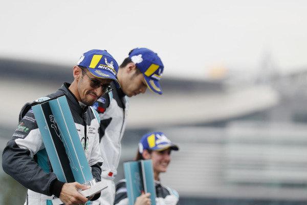 The PRO AM class podium: Bandar Alesayi (SAU), Saudi Racing, 2nd position, winner Yaqi Zhang (CHI), Team China, and Célia Martin (FRE), Viessman Jaguar eTROPHY Team Germany, 3rd position