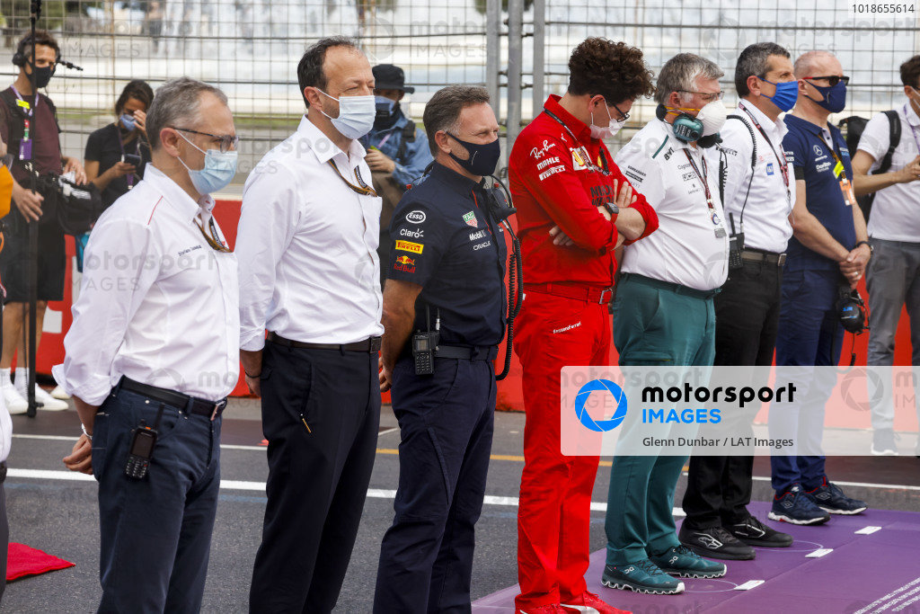 Stefano Domenicali, CEO, Formula 1, stands with team principals and others for a minutes silence in memory of Mansour Ojjeh
