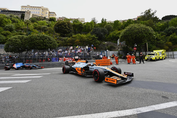 Daniel Ricciardo, McLaren MCL35M, leads Fernando Alonso, Alpine A521