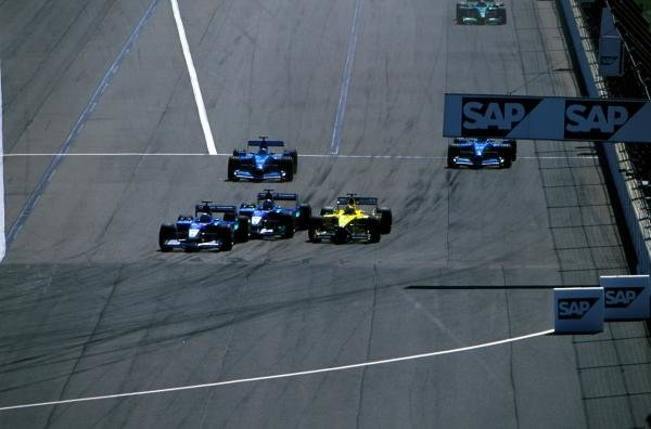 Kimi Raikkonen (FIN) Sauber is squeezed by the Jordan of Jarno Trulli (ITA) and the Sauber of team mate Nick Heidfeld (GER). Raikkonen lost his front wing and eventually retired. United States Grand Prix, Indianapolis, 30 September 2001 BEST IMAGE
