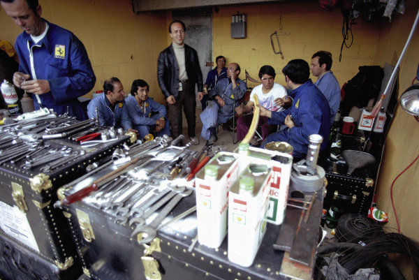 Ferrari mechanics in the pits.