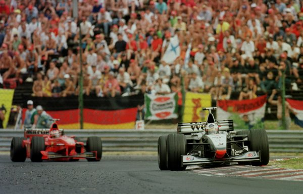 1998 Hungarian Grand Prix.Hungaroring, Budapest, Hungary.14-16 August 1998.David Coulthard (McLaren MP4/13 Mercedes-Benz) leads Michael Schumacher (Ferrari F300). They finished in 2nd and 1st positions respectively.World Copyright - Steve Etherington/LAT Photographic