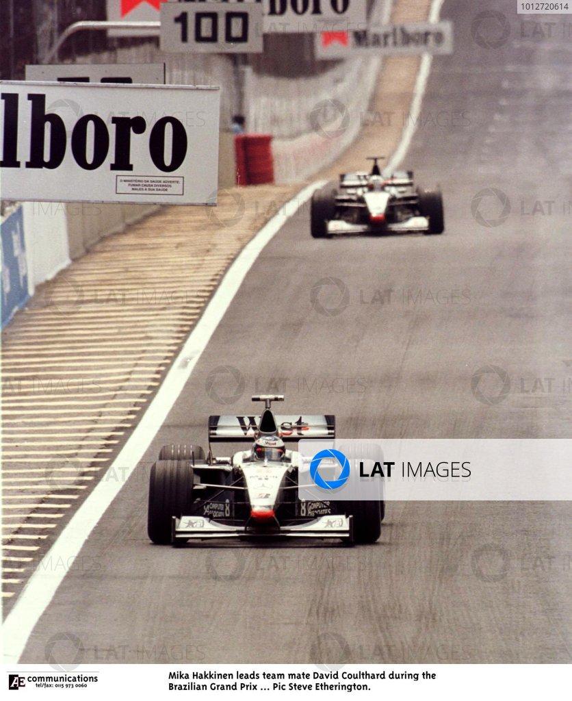 1998 Brazilian Grand Prix.Interlagos, Sao Paulo, Brazil.27-29 March 1998.Mika Hakkinen leads David Coulthard (both McLaren MP4/13 Mercedes-Benz). Hakkinen finished in 1st position.World Copyright - Steve Etherington/LAT Photographic