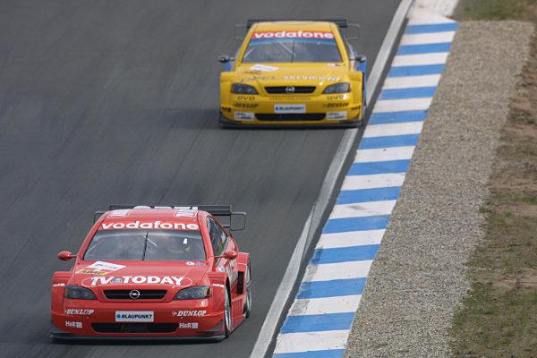2002 DTM Championship Race.Hockenheim, Germany. 20-21 April 2002.Joachim Winkelhock leads Alain Menu.World Copyright: Spinney/LAT Photographic.Ref.: 8 5mb Digital Image Only.