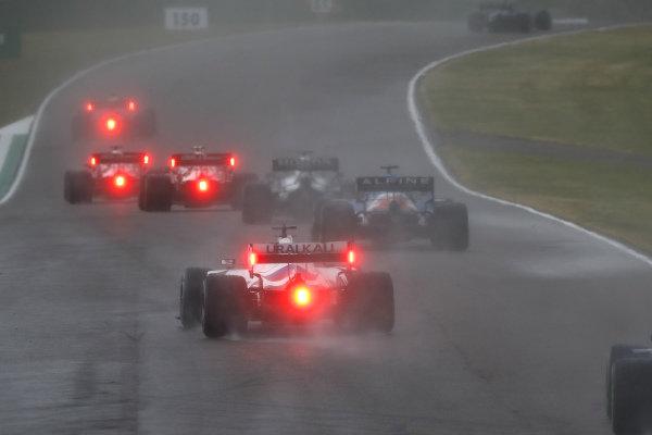 Yuki Tsunoda, AlphaTauri AT02, leads Fernando Alonso, Alpine A521, and Nikita Mazepin, Haas VF-21