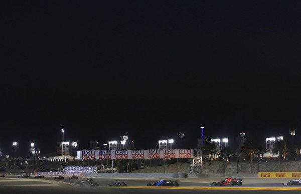 Esteban Ocon, Alpine A521, leads George Russell, Williams FW43B, and Sergio Perez, Red Bull Racing RB16B