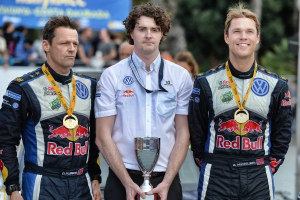 Race winner Andreas Mikkelsen (NOR) / Ola Floene (NOR) Volkswagen WRC celebrate on the podium at FIA World Rally Championship, Rd12, RAAC Rally de Espana, Day Three, Costa Daurada, Catalunya, Spain, 25 October 2015.