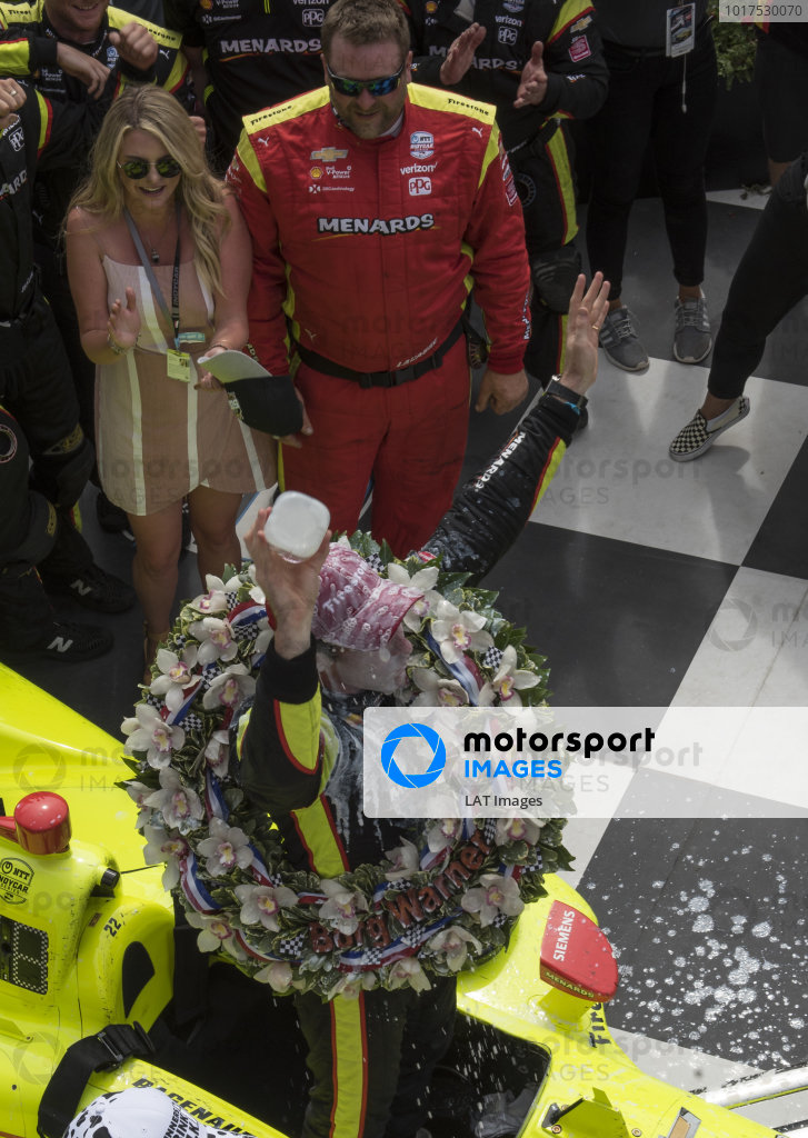 Simon Pagenaud, Team Penske Chevrolet, pours milk over his head in victory lane.