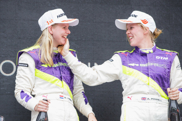 Beitske Visser (NLD) celebrates on the podium after winning the race with Alice Powell (GBR)
