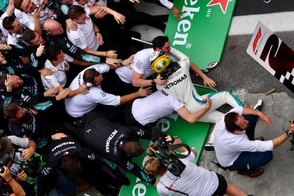 Barriers Collapse while Lewis Hamilton, Mercedes AMG F1 celebrates in Parc Ferme with his mechanics