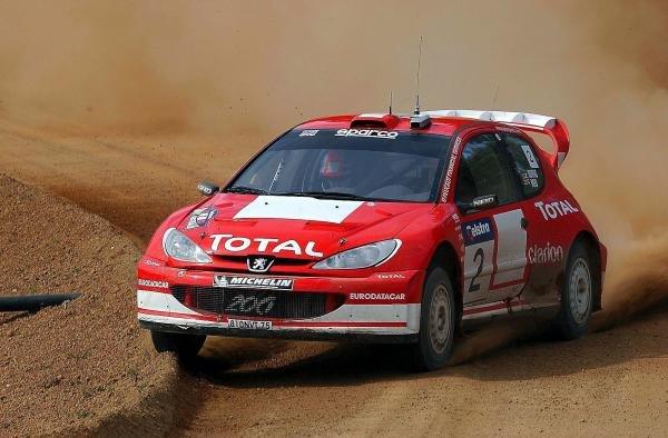 Richard Burns (GBR) / Robert Reid (GBR) Peugeot 206 WRC.World Rally Championship, Rd10, Telstra Rally Australia, Day Three, Perth, Australia, 7 September 2003.DIGITAL IMAGE