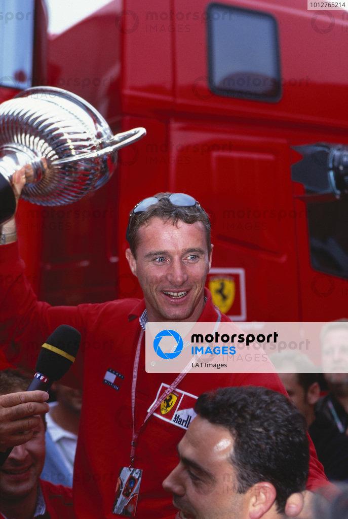 1999 Austrian Grand Prix.A1 Ring, Zeltweg, Austria.23-25 July 1999.Eddie Irvine (Ferrari) celebrates his 1st position.Ref-99 AUT 72.World Copyright - LAT Photographic
