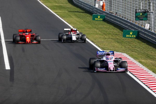 Lance Stroll, Racing Point RP19, leads Antonio Giovinazzi, Alfa Romeo Racing C38, and Sebastian Vettel, Ferrari SF90