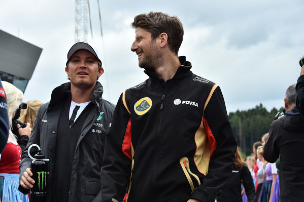 Nico Rosberg (GER) Mercedes AMG F1 and Romain Grosjean (FRA) Lotus F1 on the drivers parade at Formula One World Championship, Rd8, Austrian Grand Prix, Race, Spielberg, Austria, Sunday 21 June 2015.
