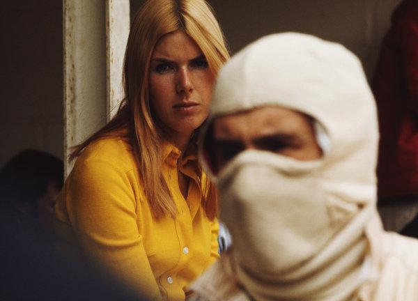 Helen Stewart looks over towards Jackie Stewart in the pits.