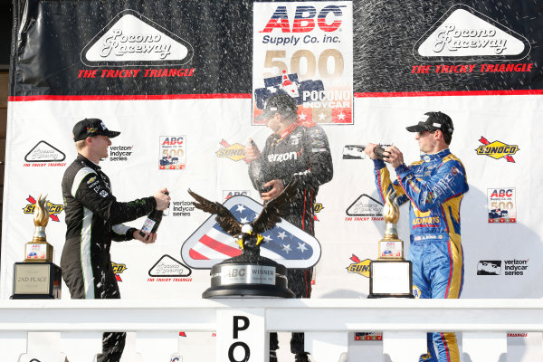 Verizon IndyCar Series ABC Supply 500 Pocono Raceway, Long Pond, PA USA Sunday 20 August 2017 Will Power, Team Penske Chevrolet, Josef Newgarden, Team Penske Chevrolet, Alexander Rossi, Curb Andretti Herta Autosport with Curb-Agajanian Honda celebrate with champagne on the podium World Copyright: Phillip Abbott LAT Images ref: Digital Image abbott_pocono_0817_8077