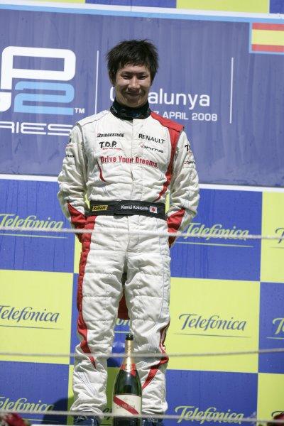 2008 GP2 Series. Round 1. Sunday Race.Barcelona, Spain. 27th April 2008Kamui Kobayashi (JPN, Dams) celebrates his victory on the podium. World Copyright: Alastair Staley/GP2 Series Media Service.ref:__P9O6131 jpg