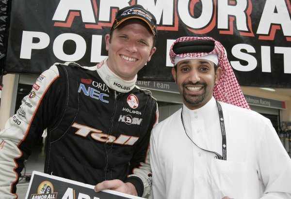 V8 Supercars Championship Round 12. V8 Supercars driver Carth Tander is presented with a cheque from  Sheikh Salman bin Isl Al Khalifa after taking pole for race 1 in Bahrain for the V8 Supercars Desert 400 this week. November 23-25, 2006. Mark Horsburgh
