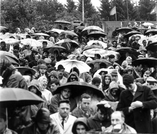 1966 Belgian Grand Prix.Spa-Francorchamps, Belgium. 12 June 1966.The fans shelter from the rain, atmosphere.World Copyright: LAT PhotographicRef: 34828