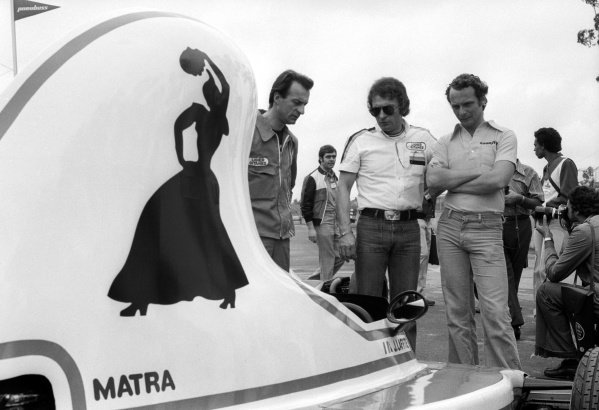 Gerard Ducarouge (FRA) Ligier Team Manager (Centre) shows off his new Ligier JS5, complete with distinctive teapot air box, to race winner Niki Lauda (AUT) Ferrari (Right).