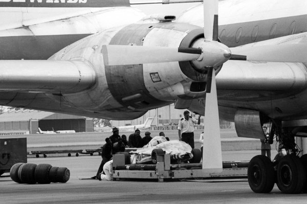 A Wolf WR1 is loaded to the freight of the Bristol Britannia airplane at the airport for return back to England.South African Grand Prix, Rd 3, Kyalami, South Africa, 5 March 1977.