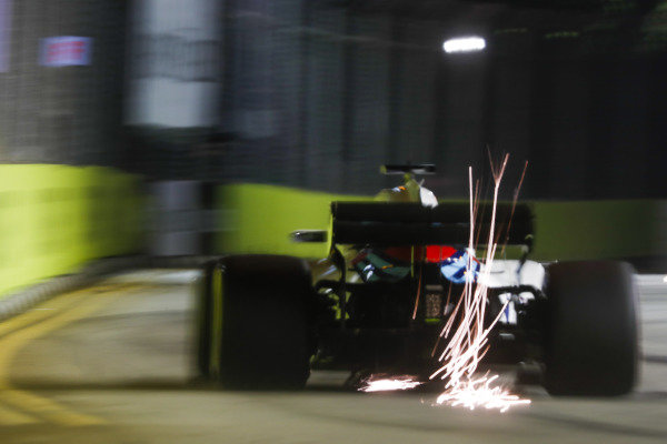 Sparks fly from the rear of Lance Stroll, Williams FW41.