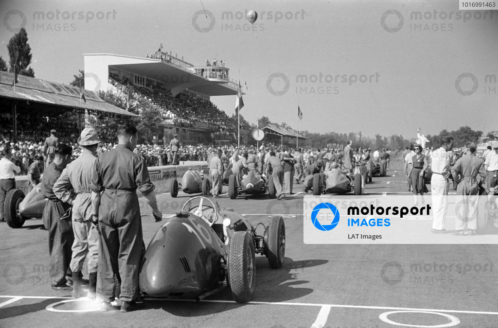 Peter Whitehead's Ferrari 125 being pushed to its grid position.