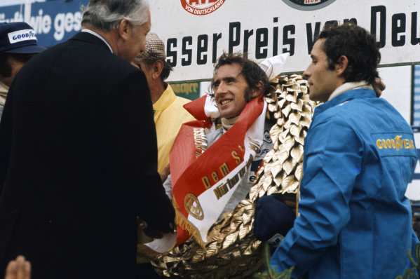 Jackie Stewart, 1st position, on the podium with Jacky Ickx, 3rd position.