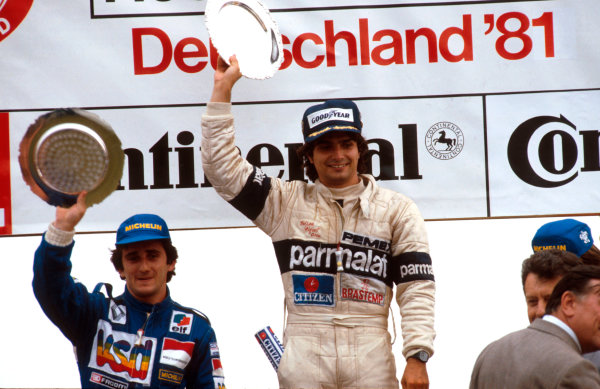1981 German Grand Prix.Hockenheim, Germany.31/7-2/8 1981.Nelson Piquet (Brabham Ford) 1st position and Alain Prost (Equipe Renault) 2nd position on the podium.Ref-81 GER 02.World Copyright - LAT Photographic
